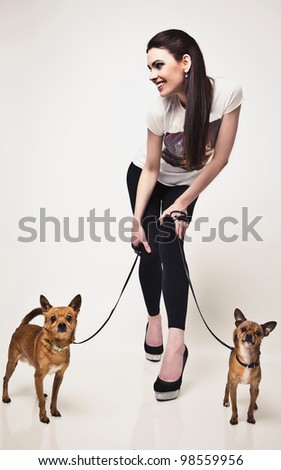 Happy young attractive woman with two dog.