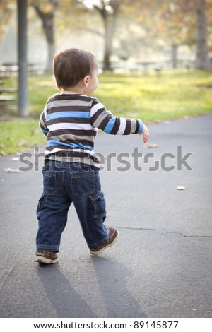 Happy Young Baby Boy Walking in the Park.