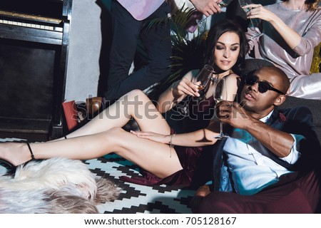 happy young beautiful couple on party drinking champagne #705128167