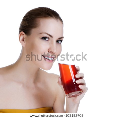 Happy young beautiful female holding glass of fresh juice