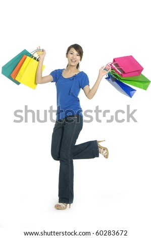 happy young beautiful girl with the bags