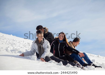 happy young beautiful people group have fun and enjoy fresh snow at beautiful winter day