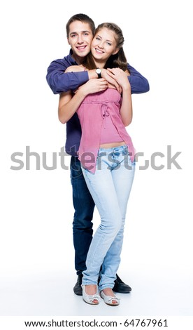 Happy young beautiful smiling couple - isolated. Full-length portrait