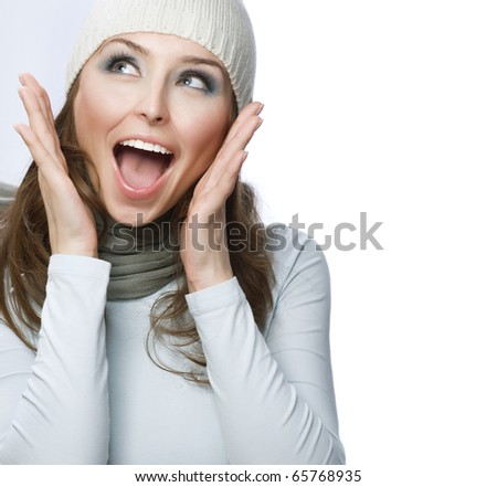 Happy Young Beautiful Woman.Surprised winter Girl over white