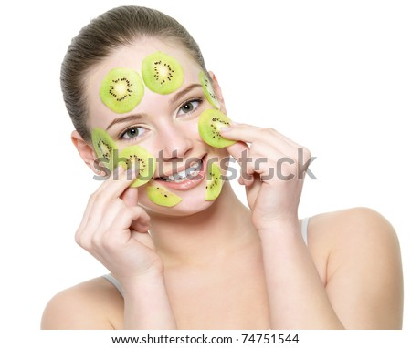Happy young beautiful woman with a fruit kiwi mask on a face - isolated on white background