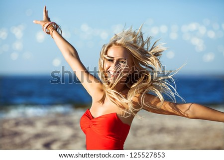 happy young beauty woman on sea beach , birds flying around - stock photo