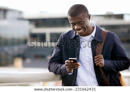 happy young black african man with cell phone having conversation on mobile #231662431