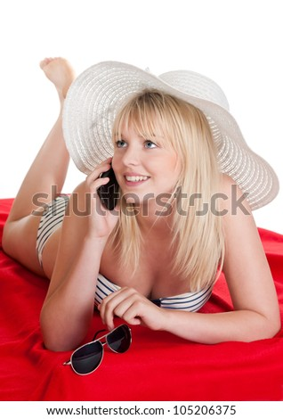 happy young blond woman with mobile phone