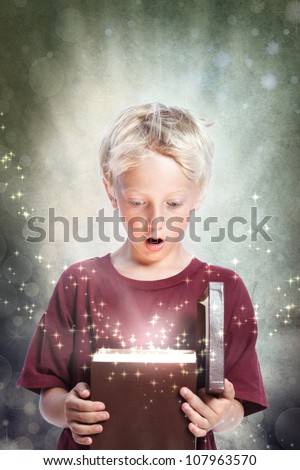 Happy Young Blonde Boy Opening a Gift Box
