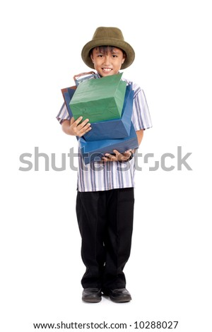 happy young boy carrying his shopping bag