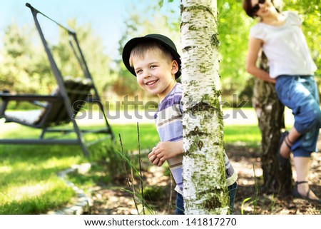 Happy young boy in garden