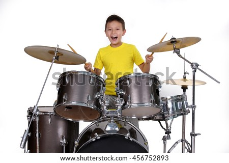 Happy young boy playing drums #456752893