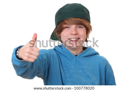 Happy young boy with thumbs up on white background