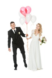 happy young bride and groom with air balloons isolated on white