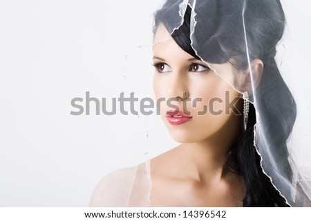 Happy young bride with veil and red lips
