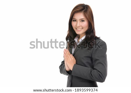 Happy young business Asian woman with Thai culture Sawasdee,Welcome expression Sawasdee,concept positive emotions and facial expression,portrait of beautiful Asian woman, isolated on white background Сток-фото ©