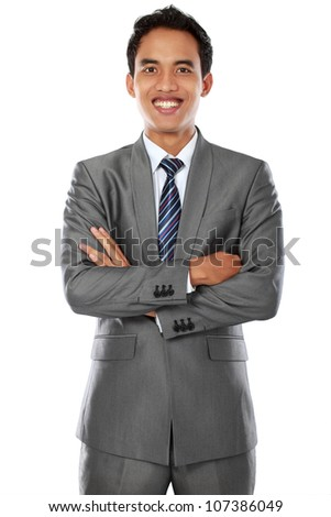 Happy young business man looking at camera with arm crossed isolated over white background