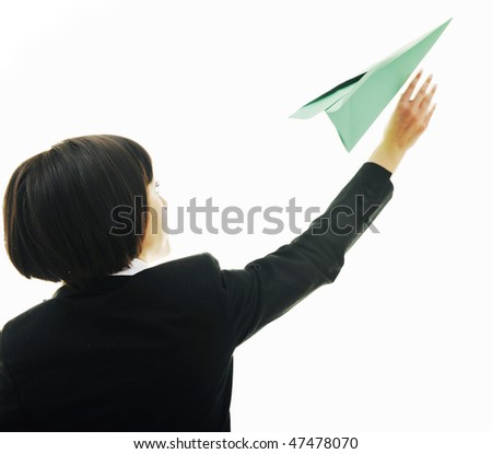 happy young business woman isolated on white throwing paper airplane - stock photo
