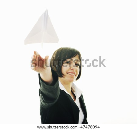 happy young business woman isolated on white throwing paper airplane