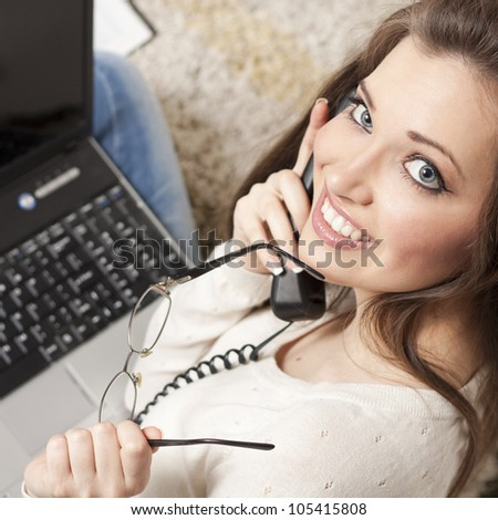 Happy young business woman on the phone
