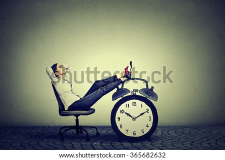 Happy young business woman relaxing sitting in her office. Stress free time management concept  Stock fotó ©