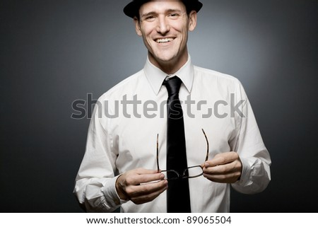 Happy young  businessman in white shirt and black hat.