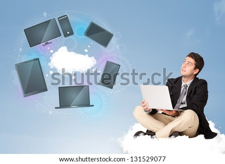 Happy young businessman sitting on cloud enjoying cloud network service