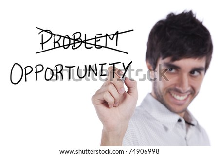 Happy young businessman turning a problem in opportunity (selective focus) - stock photo