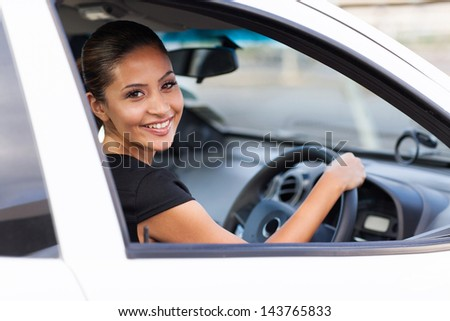 happy young businesswoman inside her new car #143765833