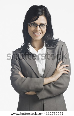 Happy young businesswoman smiling