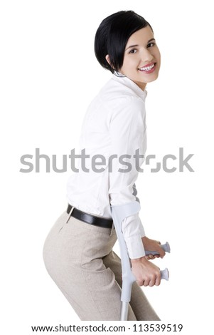 Happy young businesswoman with crutches, isolated on white. Disabled person in work.