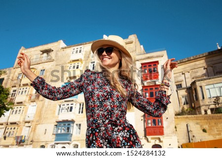 Happy young carefree woman enjoying sightseeing in Valletta, Malta, Europe #1524284132