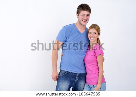 happy young casual couple portrait isolated on white background