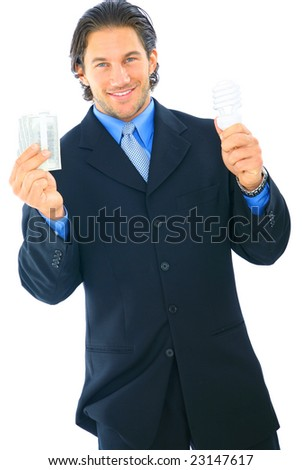 happy young caucasian businessman holding money and light bulb. concept for energy saving