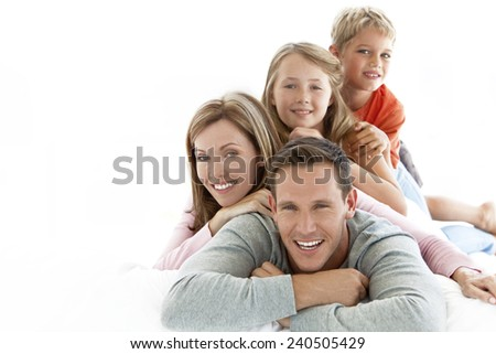 Happy young Caucasian family making a human pyramid #240505429
