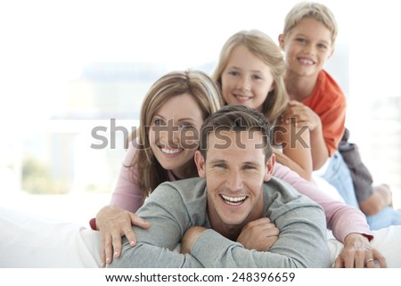 Happy young caucasian family making a human pyramid #248396659