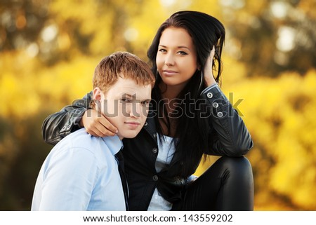 Happy young couple against an autumn nature background