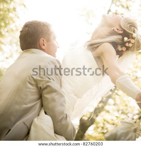happy young couple and the bright rays of light - stock photo