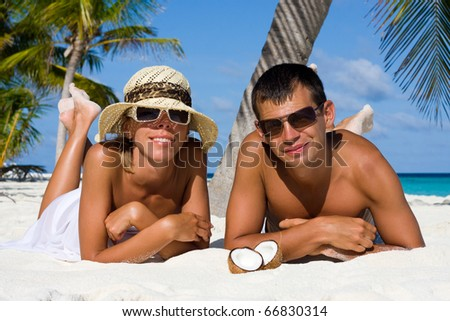 Happy young couple at the beach