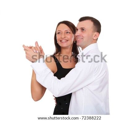 happy young couple dancing together in studio
