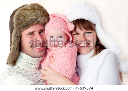 happy young couple, dressed in warm clothing and hats - stock photo