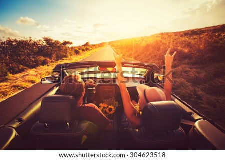 happy young couple driving...