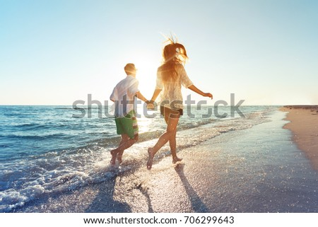 Happy young couple enjoying the sea #706299643