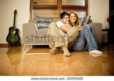 Happy young couple having fun on the sofa