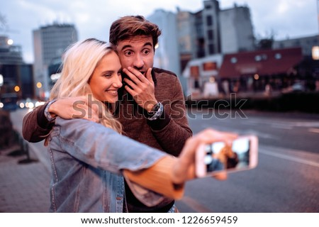 Happy young couple having fun on vacation together, #1226659459