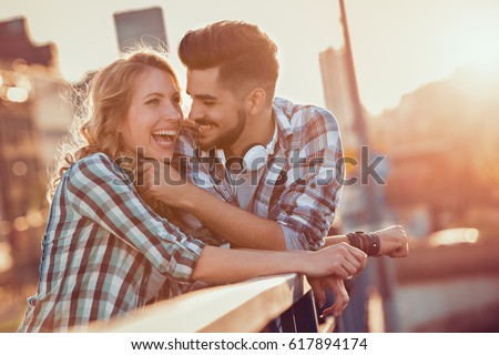Happy young couple hugging and laughing outdoors.Love concept. #617894174