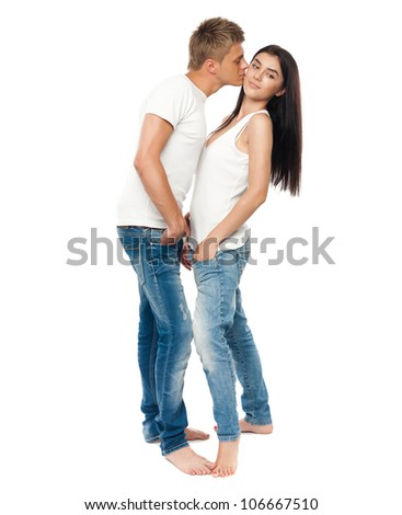 Happy young couple in casual clothing isolated on white background