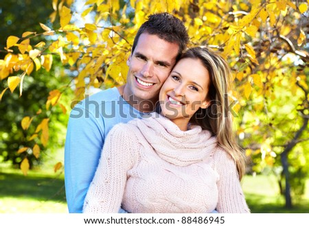 Happy young couple in love at the park.