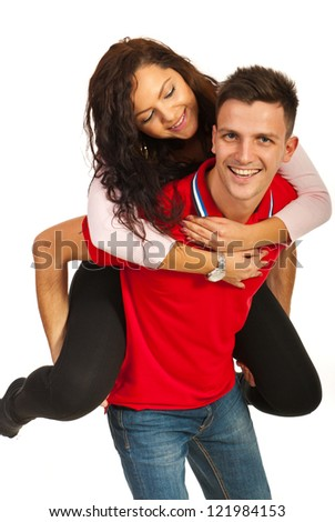 Happy  young couple in piggy back isolated on white background