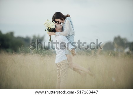 Shutterstock happy young couple in romance on summer beautiful landscape